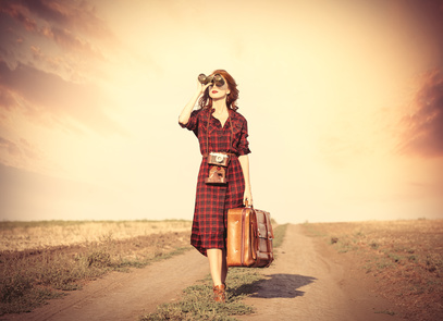 girl with bag and binocular